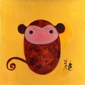 Minimalist brown baby monkey on yellow background